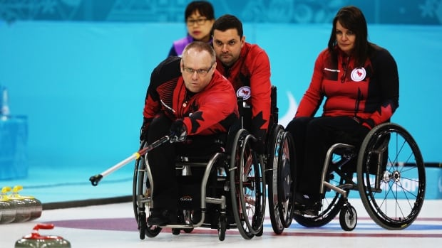 Dennis Thiessen of Canada throws a rock during a match against South Korea.