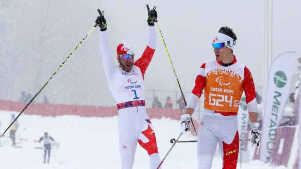 Canada's Brian McKeever, left, and his guide Graham Nishikawa made a spectacular recovery to win gold in the men's cross-country one-kilometre visually impaired race at the Sochi Paralympics.