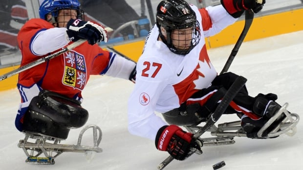 Brad Bowden, right, and the Canadian sledge hockey team are going for gold in Sochi.