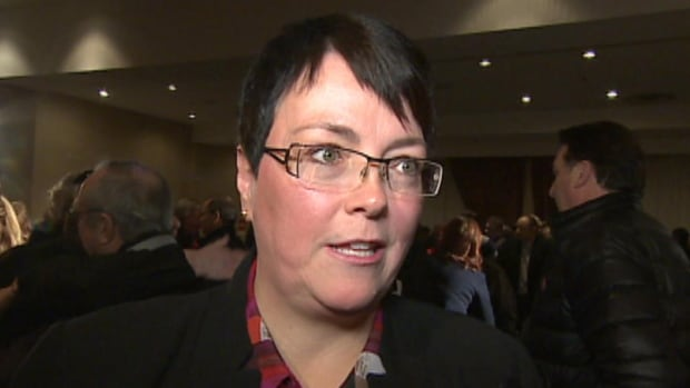 Cathy Bennett speaks with reporters after a Liberal rally at a St. John's hotel.