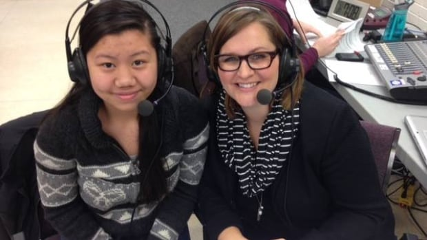 West St. Paul student Talynne Bains, left, with Information Radio host Marcy Markusa at a special live broadcast from the school on Wednesday.