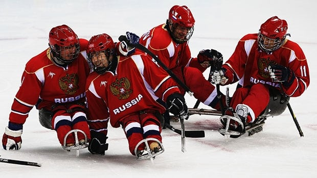 Russia celebrate the goal of Alexey Amosov during the Ice Sledge Hockey semifinal match between Russia and Norway at the Shayba Arena