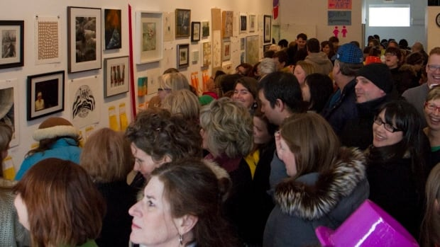 Winnipeggers thronged to MAWA's art auction in 2013.