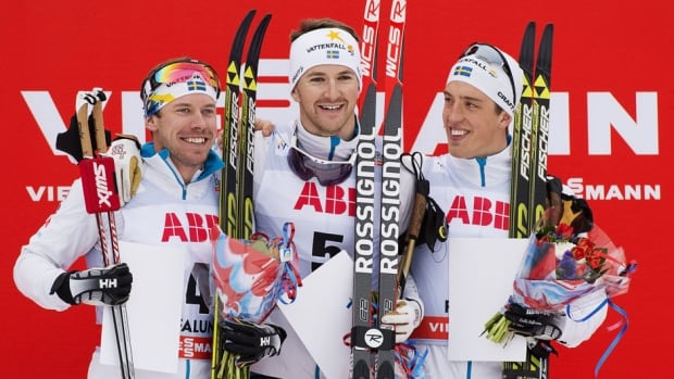 Teodor Peterson reacts next to second-place finisher Emil Joensson and Calle Halfvarsson, who placed third, during the FIS Cross-Country World Cup men's 1.4-km Sprint Classic winner's ceremony in Falun Friday.