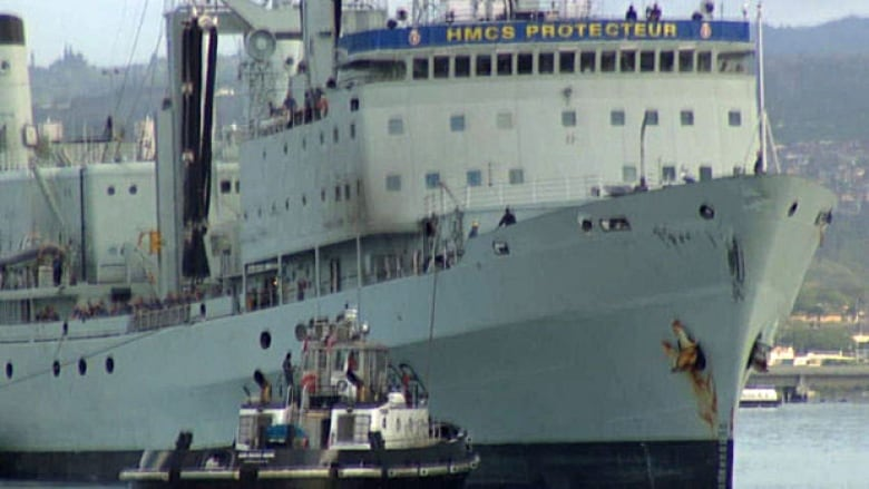 HMCS Protecteur heading home under tow from U S  navy tug