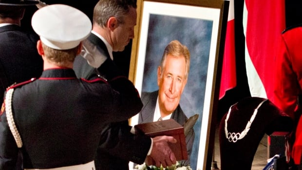 "The ashes of the late Ralph Klein are laid on a table during a ""celebration of life"" for the former Alberta premier in Calgary in April 2013."