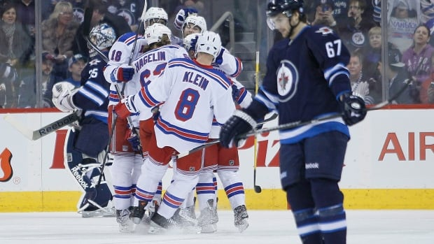 The New York Rangers celebrate Carl Hagelin's goal on Winnipeg Jets goalie Al Montoya and Michael Frolik during the second period at the MTS Centre on March 14. The Rangers defeated the Jets 4-2.