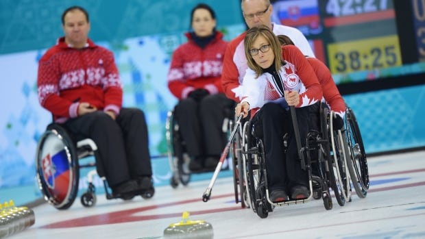 Canada's Sonja Gaudet throws a rock during wheelchair curling at the Sochi Paralympics.