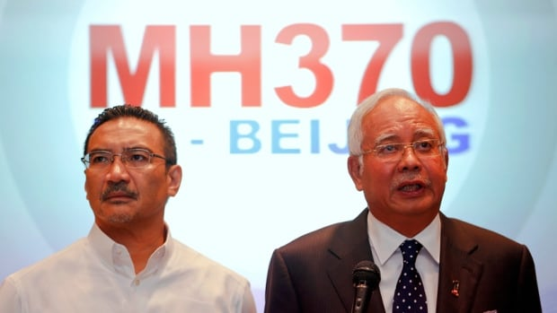 "Malaysian Prime Minister Najib Razak, right, addresses reporters as Transport Minister Hishammuddin Hussein stands by him. Najib said despite media reports that the plane was hijacked, ""all possibilities"" are being investigated as to what caused Flight MH370 to deviate from its original path."