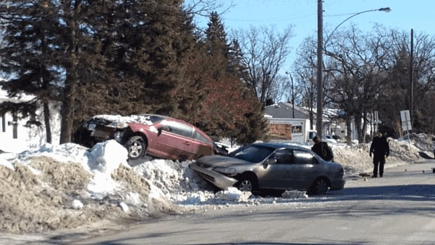 An 18-year-old man has been charged after a crash that sent two cars into a snowbank in St. Vital on Saturday.