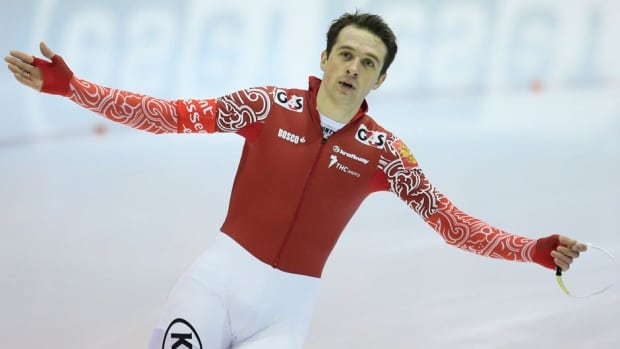 Russia's Denis Yuskov celebrates after the men's 1500-metre speedskating race during the World Cup final at Thialf skating arena on Saturday.