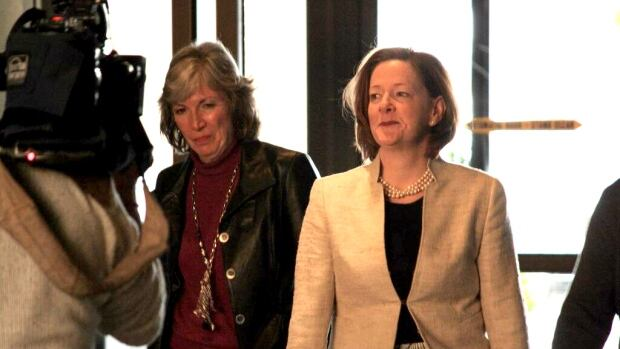 Alberta Premier Alison Redford arrives Saturday morning at a meeting with the directors of her Progressive Conservative Party.
