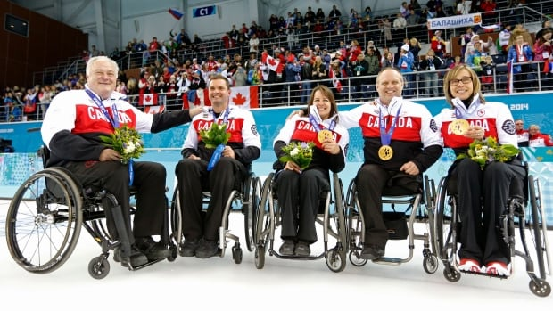 Wheelchair curling gold medallists, from left, Jim Armstrong, Joe Rea, Ina Forrest, Dennis Thiessen and Sonja Gaudet pose after winning gold — Canada's third straight at the Paralympics — on Saturday after defeating Russia.