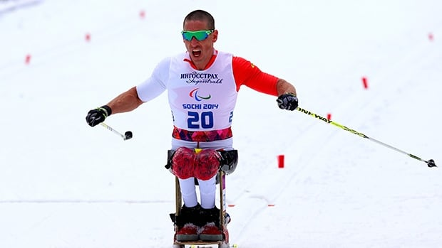 Canada's Chris Klebl powers across the finish line in the men's 10 km sitting cross-country race at the Paralympics.