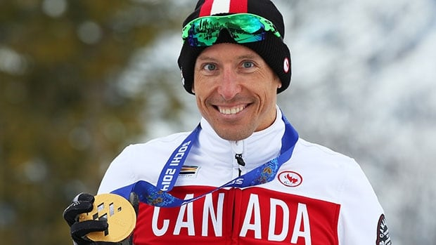Canada's Chris Klebl poses with his gold medal won in the men's 10 km sitting cross-country race at the Paralympics in Sochi.
