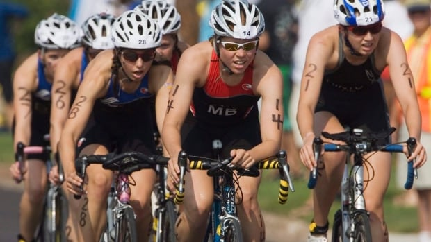 Team Manitoba's Sarah-Anne Brault (number 14) is seen competing in the individual triathlon event at the Canada Games in Summerside, P.E.I  in 2009. Brault won gold in Australia's Oceania Cup on Sunday.