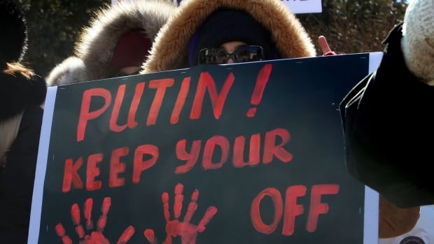 A protester takes part in a mock referendum to draw attention to the Crimean referendum Sunday March 16 outside the Russian Embassy in Ottawa.