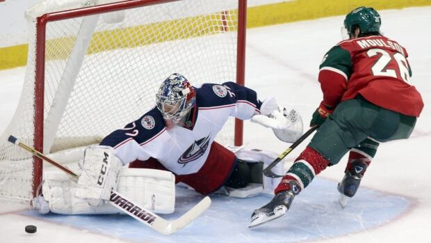 Columbus goalie Sergei Bobrovsky stops a shootout attempt by Minnesota Wild's Matt Moulson on Saturday's win for the Blue Jackets.