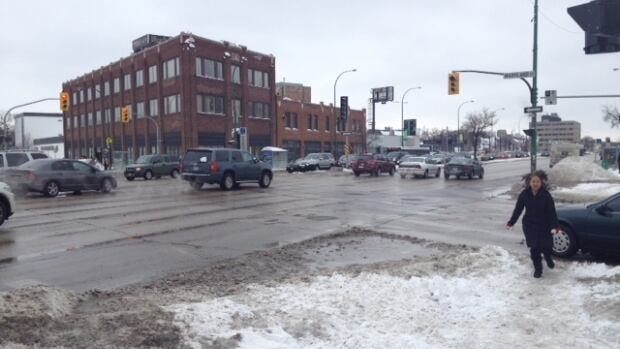 Traffic lights were out at Portage Avenue and Maryland Street in Winnipeg on Monday. City officials said moisture had caused a number of traffic lights across Winnipeg to malfunction.