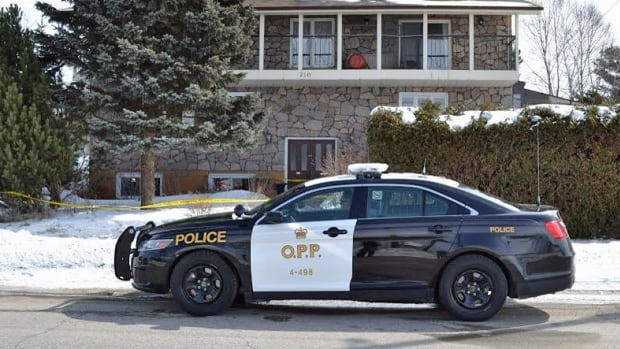 Blind River OPP keep watch over a residence that is being investigated as a crime scene on Monday. One man is dead and another man has been charged with first degree murder after a disturbance at a residence, police report.