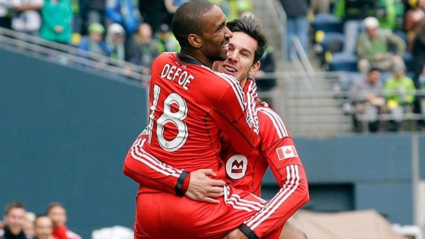 Jermain Defoe (18) Defoe scored both goals Saturday in a 2-1 road victory against Seattle Sounders FC, helping Toronto FC start its season with a win for the first time in club history.