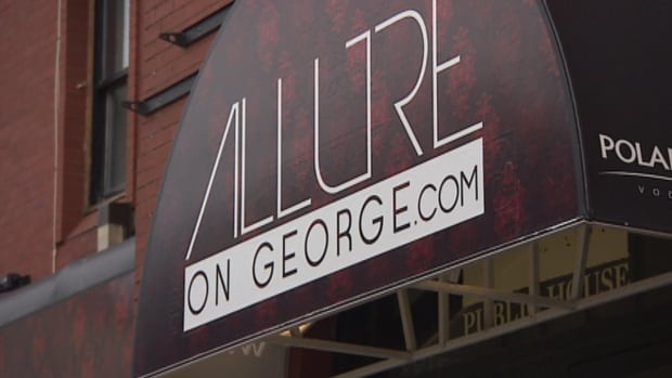 Owners of the St. John's nightclub Allure deny photos of partially nude women were taken inside their establishment.