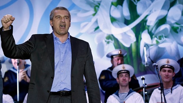 The victory pose. Crimean Prime Minister Sergei Aksyonov celebrates as the preliminary results of Sunday's referendum were announced at Lenin Square in the Crimean capital of Simferopol.