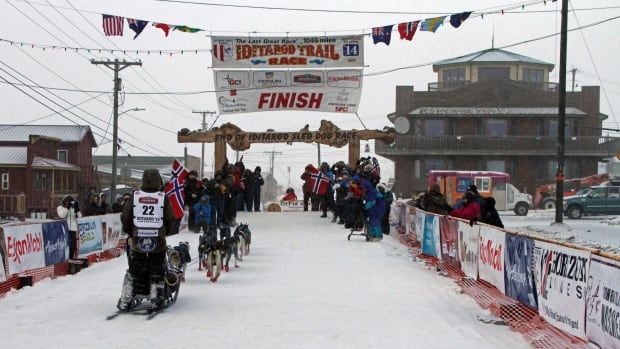 Robert Sorlie, from Hurdal, Norway, mushes to the Iditarod Trail Sled Dog Race finish line in Nome, Alaska, on March 12. Marcelle Fressineau of Whitehorse was the last musher to cross the finish line on Saturday.
