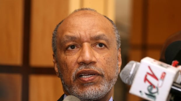In this May 10, 2011 file picture Mohamed Bin Hammam, chief of the Asian Football Confederation, talks to local media in Port of Spain, Trinidad & Tobago.