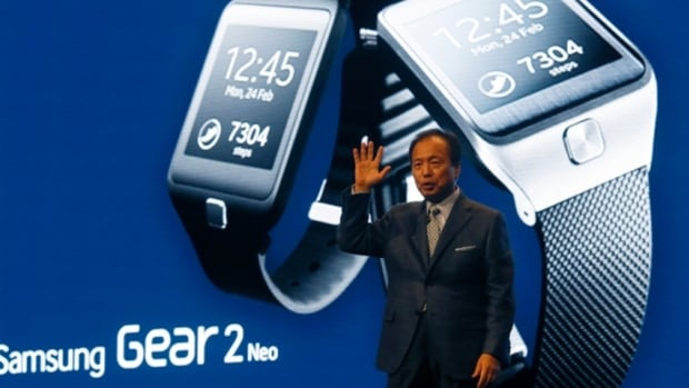 J.K. Shin, president and head of IT and Mobile Communication Division of Samsung Electronics, presents the company's new Galaxy S5 smartphone, a new smartwatch and a fitness band at the Mobile World Congress in Barcelona last month.