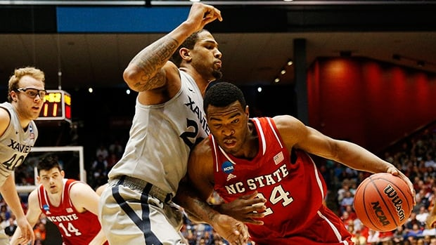 T.J. Warren of the North Carolina State Wolfpack drives against Justin Martin of the Xavier Musketeers at University of Dayton Arena on March 18, 2014 in Dayton, Ohio.