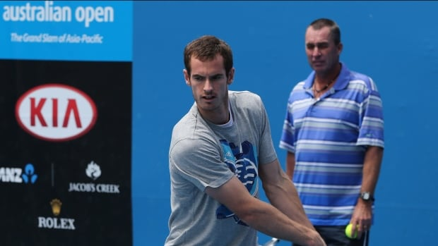Andy Murray of Britain hits a shot beside  his coach Ivan Lendl during a training session at the Australian Open in January.