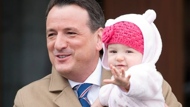 Greg Rickford leaves Rideau Hall with his daughter, Abigail Mae, after he was sworn in as minister of natural resources on March 19, 2014.