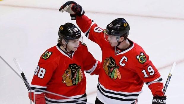 Chicago Blackhawks forward Patrick Kane, left, shown here earlier this month, will be out about three weeks.