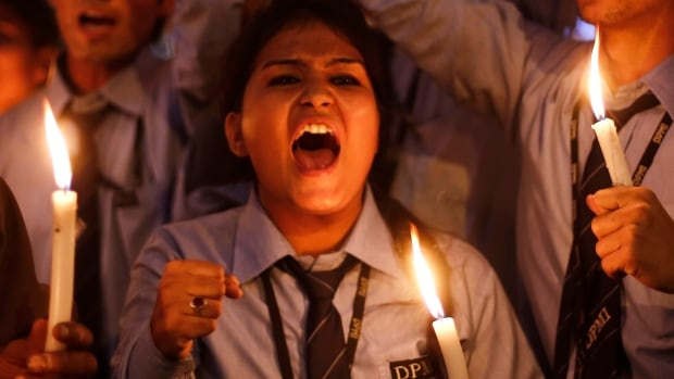 School children attend a candle light vigil to mark the first anniversary of the fatal Delhi gang rape in Dec. 2013. The 23-year-old woman's death sparked protests across India.