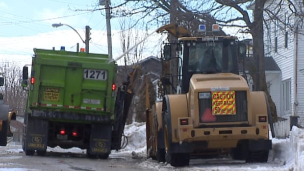 Crews remove snow from a St. John's sidewalk Wednesday.