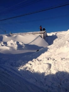 Snow up to roof of house in Port au Choix