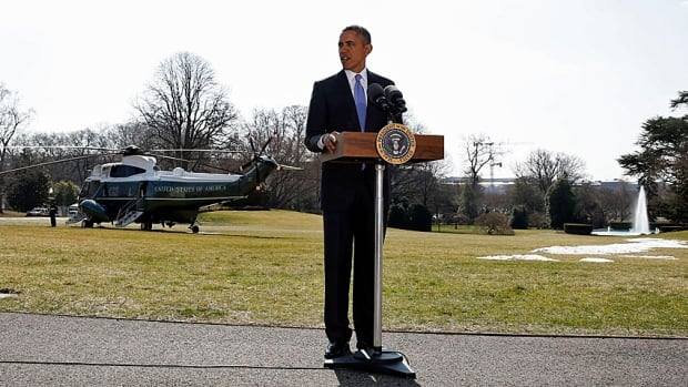 Barack Obama talks about Ukraine before boarding Marine One on the south lawn of the White House on Thursday. Announcing further sanctions against prominent Russians has not stopped a chorus of GOP critics from asking for much more.