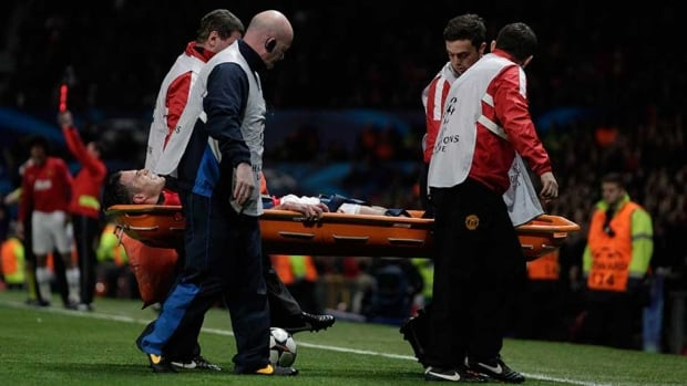 Manchester United's Robin van Persie is carried off injured during his team's during their Champions League match on Wednesday.