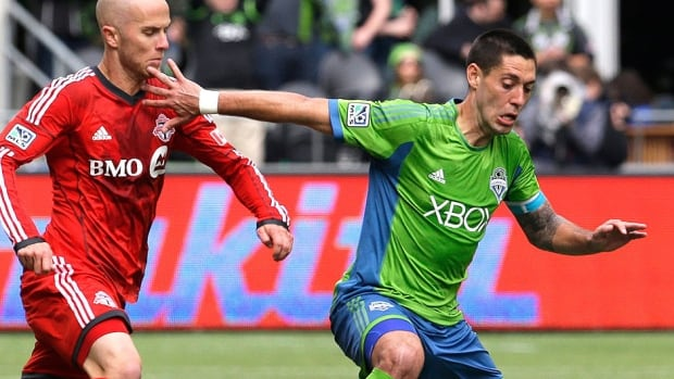 Sounders midfielder Clint Dempsey, right, was suspended two games for violent conduct toward Toronto FC defender Mark Bloom, not pictured.