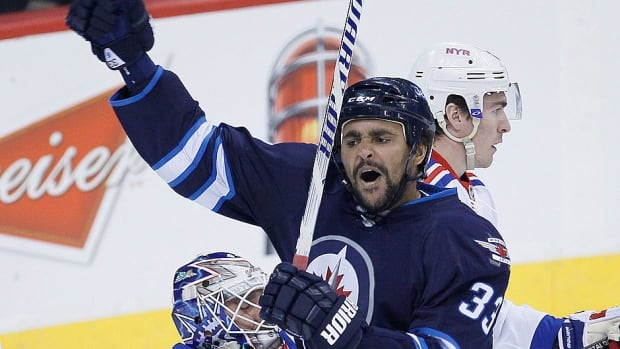 Jets head coach Paul Maurice is fairly optimistic forward Dustin Byfuglien, pictured here, would return for Saturday's game against Carolina along with forward Jim Slater and defenceman Zach Bogosian.