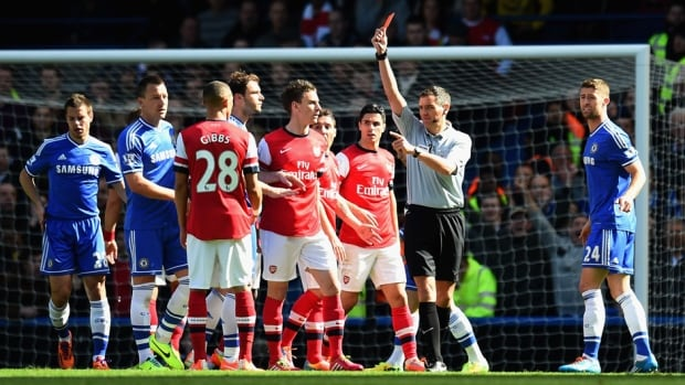 Referee Andre Marriner shows Kieran Gibbs of Arsenal a red card during the Barclays Premier League match between Chelsea and Arsenal at Stamford Bridge on Saturday in London.