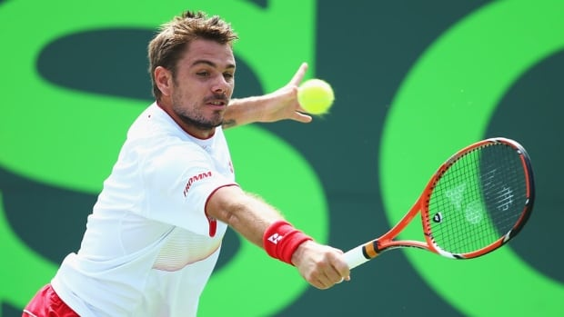 Stanislas Wawrinka returns a shot to Daniel Gimeno Traver during their match at the Sony Open at Crandon Park Tennis Center on Saturday in Key Biscayne, Fla.