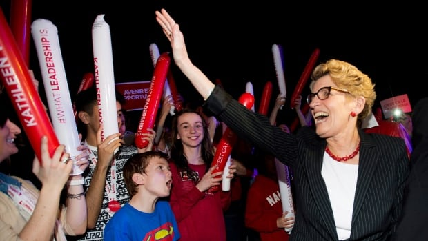 Ontario Premier Kathleen Wynne greets supporters and her caucus at a rally during the party's annual general meeting in Toronto.