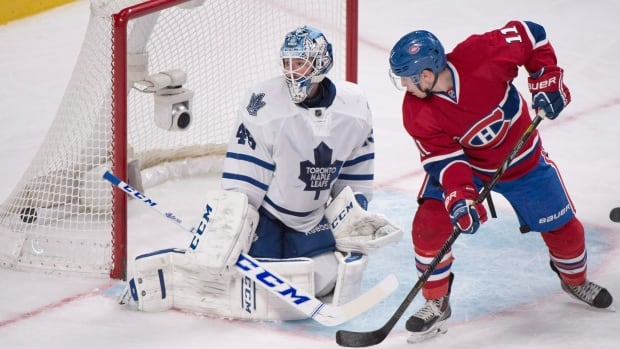 Toronto Maple Leafs goaltender Jonathan Bernier is scored on by Montreal Canadiens' P.K. Subban (not shown) as the Canadiens' Brendan Gallagher moves in on net during third period NHL hockey action in Montreal on March 1, 2014.