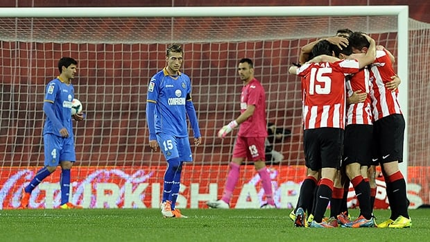 Athletic Bilbao's players celebrate a goal during against Getafe CF at the San Mames stadium in Bilbao on March 22, 2014.