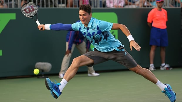 Milos Raonic stretches to play a forehand against Jack Sock at the Sony Open at Crandon Park Tennis Center on March 22, 2014 in Key Biscayne, Florida.