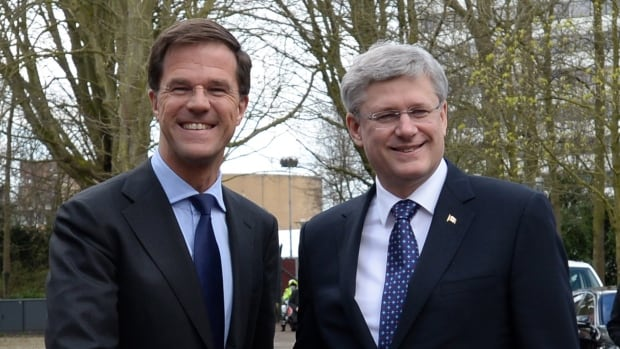 Prime Minister Stephen Harper is greeted by Prime Minister of the Netherlands Mark Rutte as he arrives at Catshuis in Hague, Netherlands, on Sunday. The two leaders met in advance of an emergency G7 summit.