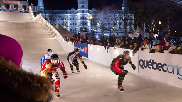 Women racers compete in the 2014 Red Bull Crashed Ice World Championship in Quebec City.