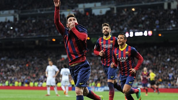 Lionel Messi of Barcelona celebrates scoring against Real Madrid at the Bernabeu on March 23, 2014 in Madrid, Spain.